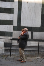 Grandpa loving on his grandbaby next to the Duomo