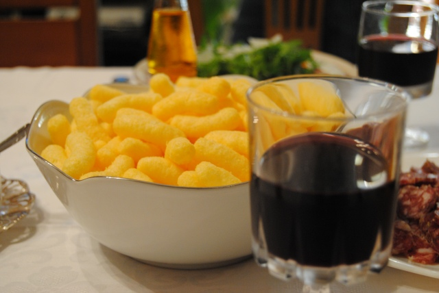 Wine is not complete without cheese puffs also known as FONZIES.